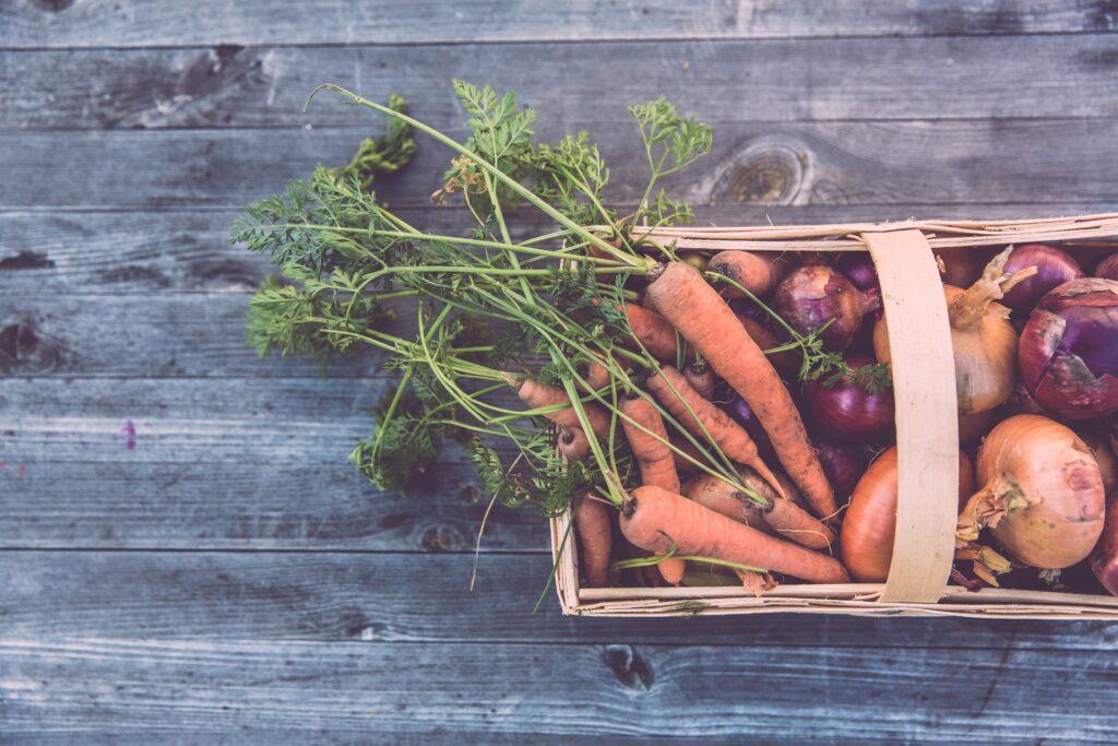 Fresh veggies fill a garden basket.